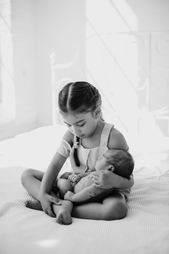 sister and baby newborn session